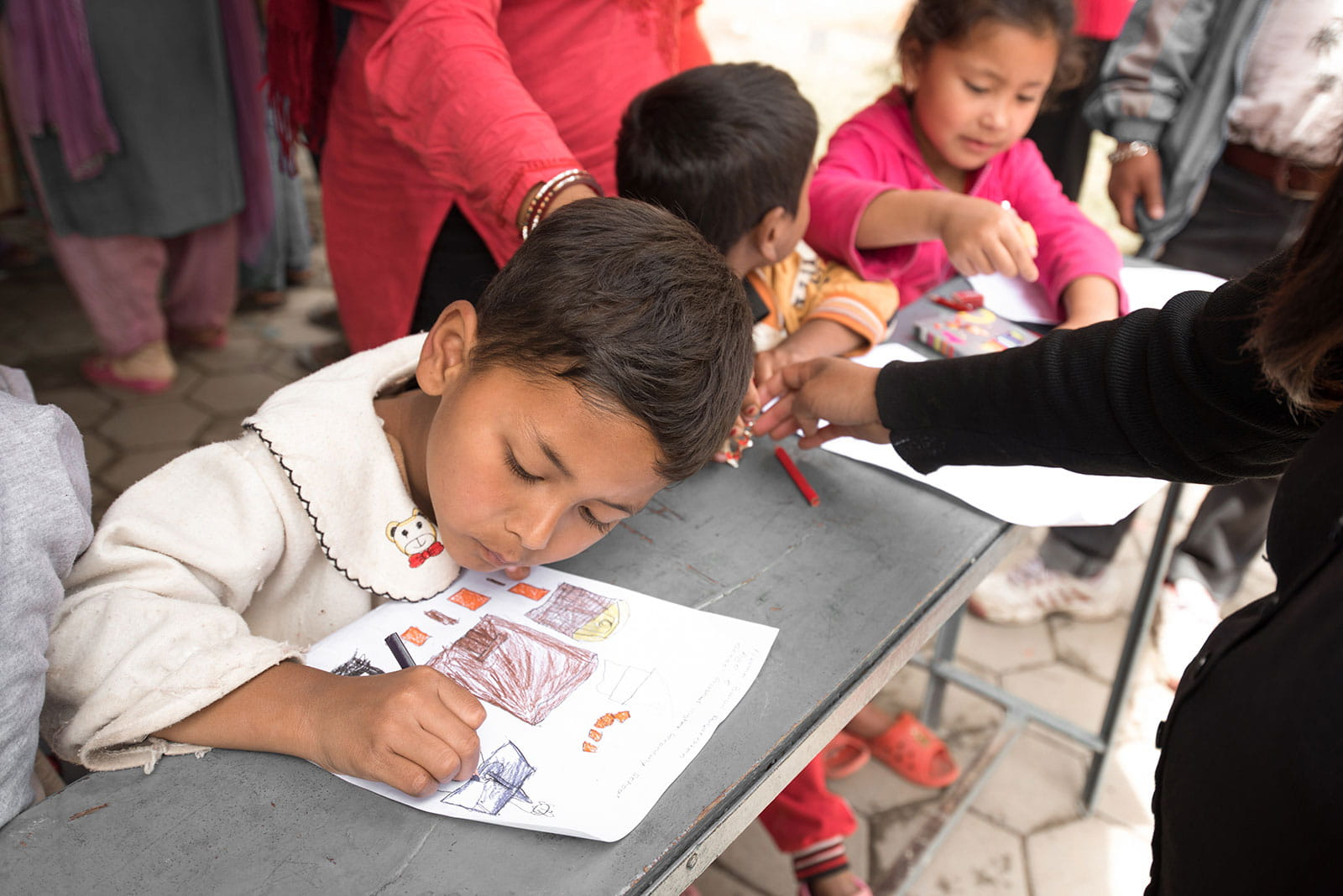 Picture of children drawing with color pencils