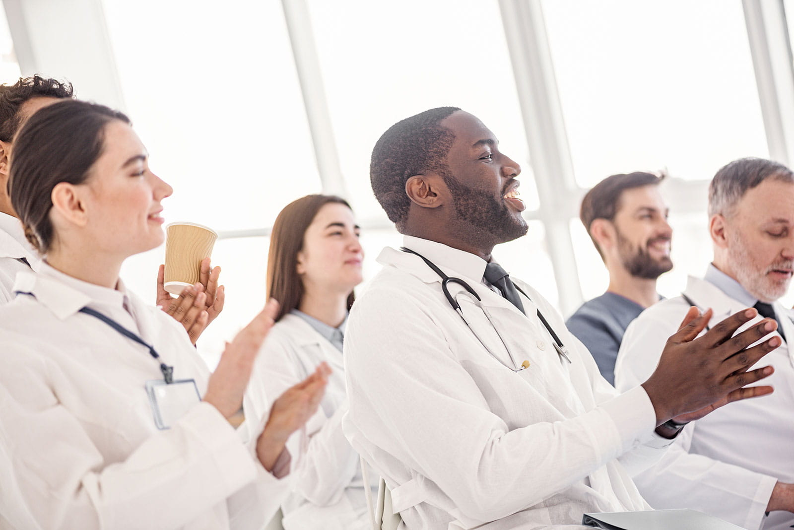 Medical professionals clapping meeting