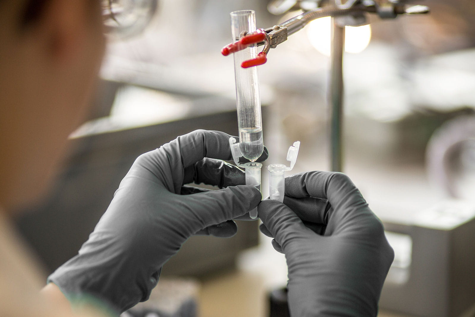 image of a scientist filling a vial
